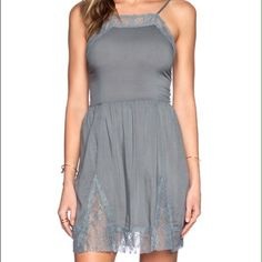 Free People Lace Swing Slip Gorgeous Lace Inset Slip Dress in vapor blue. Can be layered for a cute look. High neck fit. Thanks for checking out my closet! *black dress picture is only to show the style when worn Free People Dresses