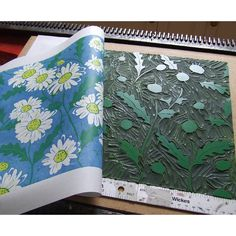 Printing up the yellow plate of my daisies linocut.