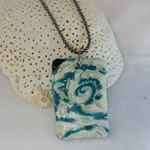 Polymer Clay necklace swirled with teal blue, translucent and pearl clay      Domestic shipping included, international customers please ask for shipping rates. Click Inselly link in bio or message me if interested.