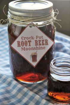 "If you like root beer you are going LOVE this alcoholic adult beverage recipe for Crock-Pot Root Beer Moonshine! Everclear grain alcohol or vodka is sweetened and flavored with root beer extract for this perfect sipping flavored ""moonshine"" recipe! Root Beer Moonshine Recipe, Flavored Moonshine Recipes, Homemade Moonshine, Apple Pie Moonshine, Salted Caramel Moonshine Recipe, Watermelon Moonshine Recipe With Everclear, Making Moonshine, Peach Moonshine, Moonshine Cocktails"