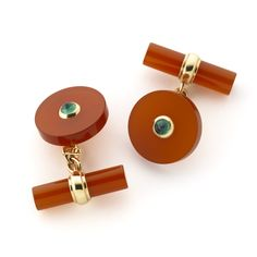 An extremely smart pair of cornelian and cabochon emerald cuff links set in 18ct…