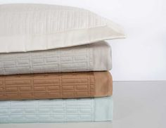 A design consisting of narrow rectangles is quilted on Egyptian cotton, Italian sateen for a contemporary look.