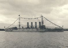 """On Dec. 14, 1911 the cruiser USS California (ACR 6) shown in this photo steamed into Pearl Harbor and became the first large warship to enter """"the best and most capacious harbor in the Pacific."""" This is one of a series of 13 new historic photographs that hang at the newly named Historic Hickam Officer's Club at Joint Base Pearl Harbor-Hickam.  Photo courtesy of the Bishop Museum"""