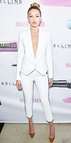 20 Woutfits to Inspire Your Summer Wardrobe | GIGI HADID  | wearing a Smythe suit (sans shirt), braided topknot and winged liner at the Maybelline New York 100th Anniversary Party in Toronto.