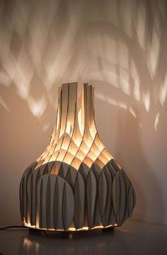 Soft Glow Cast by Original Plywood Lighting Unit from Mariam Ayvazyan - http://www.interiorredesignseminar.com/interior-design-inspirations/soft-glow-cast-by-original-plywood-lighting-unit-from-mariam-ayvazyan/