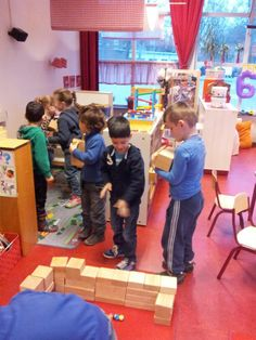 In this picture block play can be seen as an activity where children can socialize and listen to each other as they engage in their shared thoughts of creating something. It will also develop children's physical activity as they carry the blocks! Physical Activities, Activities For Kids, Block Play, Teamwork, Physics, Net, Thoughts, Children, School