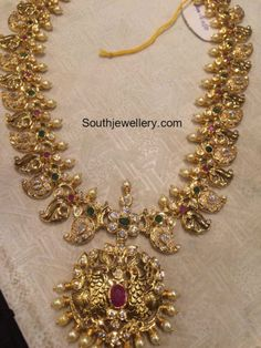 Antique gold mango mala studded with cz stones, rubies, emeralds and south sea pearls by Premraj Shantilal Jewellers. Antique Jewellery Designs, Gold Jewellery Design, Gold Jewelry, Designer Jewellery, Indian Wedding Jewelry, Indian Jewelry, Bridal Jewelry, Indian Bridal, Mango Mala Jewellery