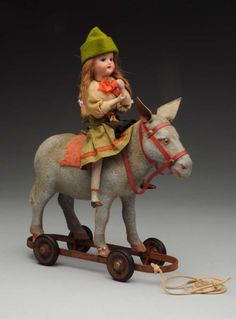 Doll on Horse Pull Toy