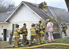 Sioux City Fire Rescue firefighters work the scene of a house fire at 1405 South Rustin Street in Sioux City, Iowa, Wednesday, Nov. 25, 2015.