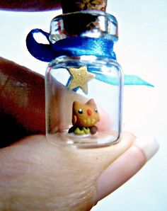 Tiny owl in a bottle