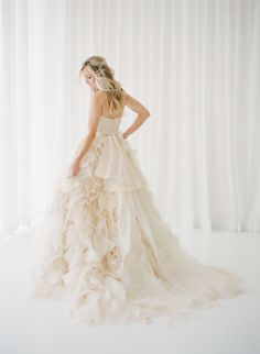We've shown you some of our favorite jaw-dropping pink wedding dresses from the SMP Lookbook and this past Bridal Week, but what about some serious inspiration from what we do best: Real Weddings. We poured through the archives to find the prettiest pink wedding dresses so you can be inspired to embody the ultimate blushing bride on your Big Day. Take a peek!