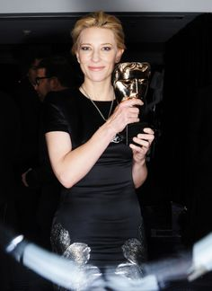 Leading Actress winner Cate Blanchett with her award backstage in the #EEBAFTAs Selfie Pod.