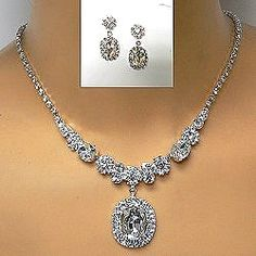 A classic rhinestone necklace set with solitaire emerald cut drop provides timeless bridal or prom jewelry.  See other styles by clicking on the link.  http://www.awnol.com/store/Rhinestone-Jewelry/Rhinestone-Sets