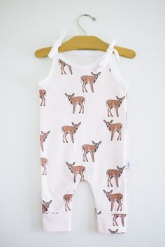 this fawn romper is made with the softest fabric for your little one's delicate and sensitive skin. these rompers are 100% USA grown GOTS certified organic cotton, the highest quality organic material with no harmful chemicals. we offer a high quality braided elastic waistband to stretch with your growing little ones.please note that all your rompers are handmade and unique, pattern placements may vary slightly from the romper pictured.machine wash warm or cool, gentle/d...