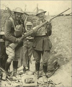 "British soldiers with a captured German ""T-Gewehl"" anti-tank rifle, WWI"