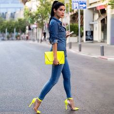 Lovely denim on denim outfit by Shani Amit with a neon yellow clutch and Christian Louboutin - Un bout