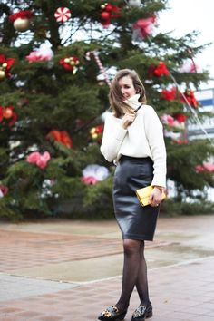 A leather skirt paired with a soft wool sweater is a perfect combination. Outfit via threadsandblooms.com