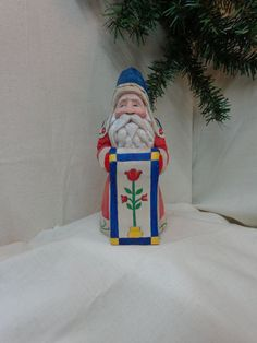 Santa with quilt hand carved wood sculpture by WeAreOutofOurGourds