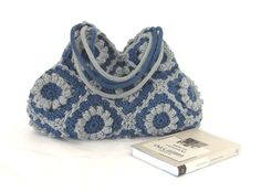 Adorable blue denim knit crochet bag for your perfect outfit. Made with wool based yarn in the all time favorite granny squares pattern with big crochet flowers. Fully lined with a pure cotton inside, two slip pockets inside and magnet snap button fastening. Double knitted and movable handles for shoulder carrying. This lovely crochet bag can be a great accessory for parties or city walk. width : 15 inches (38cm) high without handles : 9 inches (22cm) high with handles :14 inches (35cm) C...