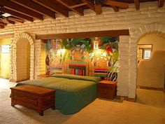 Beautiful Painted Mural surrounded by Spanish Brick Walls in this Sedona Master Suite
