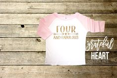 Young wild & three shirt printed with gold glitter.  Toddler Baseball T-Shirt - 3/4 Sleeve, 65% Polyester 35% Cotton Color: White with Baby Pink Sleeve Size: 2T, 4T, 5T  All items are professionally printed with highest quality glitter vinyl. Production time is 3-5 business days.  Wash on delicate, tumble dry low. The glitter will not come off or flake off at all. It is guaranteed to last.  Each item is handmade to order. Please view our Store Policies before purchasing. All sales ar...