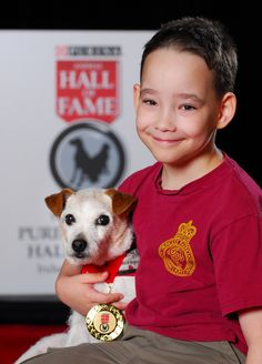 """Boy Makes His Dying Service Dog's Wishes Come True    Bingo came into Cole Hein's life when he was just two-years-old in order to assist the boy with an undiagnosable disorder that stops Cole from breathing. The dog has saved Cole's life on countless occasions. When Bingo was diagnosed with a debilitating disease, Cole decided to create a """"lick it list"""" of things he wanted for Bingo to experience before she dies."""
