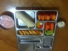 Planet box lunch, turkey wrap, fresh fruit, cucumbers & carrots w dip, cheddar chips, strawberry yogurt w gummy bears & a mint!