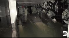 Escalators to the South Ferry Whitehall St. subway in the financial district of Manhattan are shown flooded in the aftermath of Hurricane Sandy