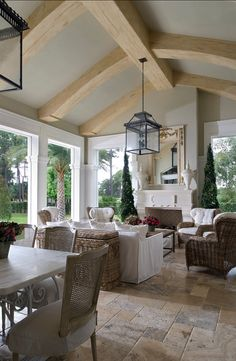French inspired Sun room. The floors are a honed limestone in a random pattern with tumbled edges.