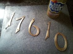 Bar Keepers Friend can revive original house numbers. They are going back up!