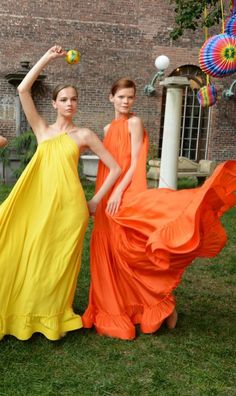 Stella McCartney's Resort Fiesta: models wearing and dancing in colorful yellow and green flowing gowns