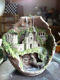 Ancient miniature castle inside broken pot.