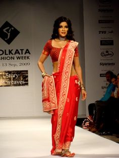 Nandana Sen in traditional chilli-red saree.