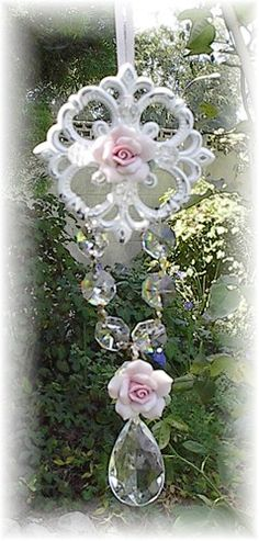 suncatcher....find an interesting old piece of architecture and add to it with crystals and ribbon....