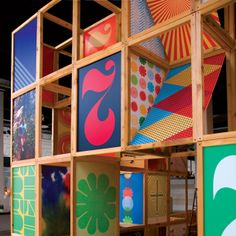 This is a pop up mobile display made by nike.  Constructed from wooden crates combined with colorful graphics that form a rhubix cube effect. The multiple points of entry allow for a better flow of heavy foot traffic, By walking into the structure the public would be emersing themselves into a new world and witnessing pop up shop as an experience
