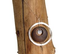 """""""Geometric glamour"""" #Silver and circular shapes join forces in this chic silver and #wood #necklace. Fun to wear and super #stylish to boot. - $49.99  Pendant size: 55 mm."""
