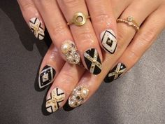 # NAILS GOLD, BLACK, WHITE, W/ RINGS