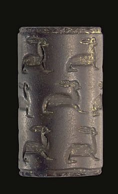 A SYRIAN HAEMATITE CYLINDER SEAL   CIRCA MID 19TH-18TH CENTURY B.C.   Engraved with three rows of hares, with long necks and rounded bodies, the ears pointing out horizontally