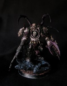 Nurgle Terminator... Over on the Bolter & Chainsword some guy has converted and painted a whole Nurgle warband to a very high standard. Different look than mine, newer bits, newer paints, use of Devlan Mud was likely prominent. ;-) More pics on the forum.