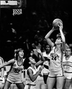 University of Oregon basketball player Bev Smith (#24) putting up a shot against Louisiana State while teammate Alison Land (#52) looks on during a first-round game of the Giusti Tournament played at Memorial Coliseum in Portland on December 16, 1981 and won by the Ducks 63-59. ©University of Oregon Libraries - Special Collections and University Archives