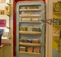 Some call it a fridge. Grandma called it an icebox. The Swedes use a kylskap and the Germans keep their milk in a kuhlschrank. At Exit 9 Gift Emporium in Brooklyn, NY, they call it a display fixture.  It's mounted right beside their book area and it displays their paper goods in a very cool way. *Snack products or glass bottles?*