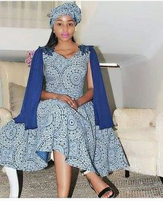 South African Shweshwe Dresses are both simple and elegant; with the unique colors of South African shweshwe dresses that make the girl wearing them look differ African Wedding Attire, African Attire, African Wear, African Women, African Dress, African Clothes, Ankara Dress, African Beauty, African Style