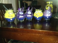 Minion centerpieces for minion party blue streamers for the overalls and yellow or purple for the body,print out glasses from google and stick them on with tape,use construction paper for the top or ribbon,glasses u can get at dollar tree or hobby lobby
