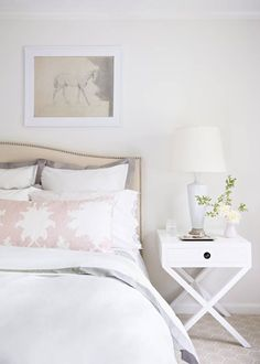 All white Everything in a bedroom with the subtlest pop of blush pink. Click through for the details. | glitterinc.com | @glitterinc