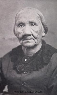 "Margaret Grey-Eyes ""Mother"" Solomon, last Wyandot Indian, ca. 1880. Her family lived on the Grand Reserve, the twelve-by-nineteen square mile reservation in what is now known as Wyandot County. She attended the first school on the reservation, established by missionary John Stewart. In July 1843 she, her first husband David Young and their children, were among the tribe members relocated to Kansas City, Kansas. She and her second husband, John Solomon, returned to live in Upper Sandusky…"
