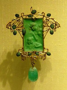 Lalique 1899-1900 'Figures in Pine Foliage' Pendant: gold, chryso-prase, enamel w/an emerald drop