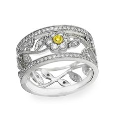 Simon G. Vintage Style Diamond Flower Ring in 18kt White Gold with 0.79 Carats of White Diamond Featuring one Fancy Yellow Diamond set in 18kt Yellow Gold.