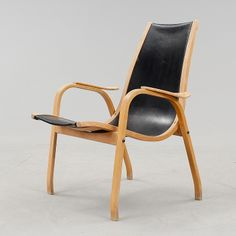 Yngve Ekström; Molded Plywood and Leather 'Arc' Armchair for ESE Furniture, c1960.