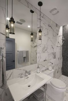 An attractive bathroom with a beautiful marbled wall. Outdoor Wall Lantern, Hanging Lanterns, Outdoor Walls, Hanging Lights, Wall Lights, Cool Lighting, Pendant Lighting, Modern Decor, Modern Design