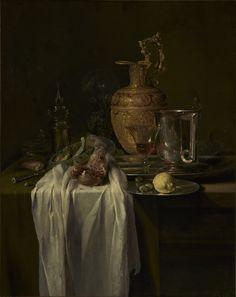 Willem Kalf: stilleven met schenkkan, glazen en een granaatappel. 1640-1649. J. Paul Getty Museum, Los Angeles. Op een wit kleed een open granaatappel en een schaal fruit. Op de rand van de tafel een zilveren bord met een citroen en 3 olijven. Daarachter een bierpul en een glas met wijn dat wordt weerspiegeld in het gepolijste oppervlak van de bierpul. Het gebroken brood, het half lege wijnglas, aangesneden fruit en het omgevallen glas duiden erop dat het maal plotseling is onderbroken.